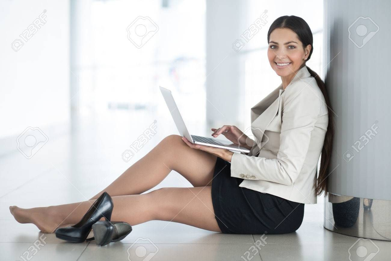 Pretty Business Woman With Laptop on Floor